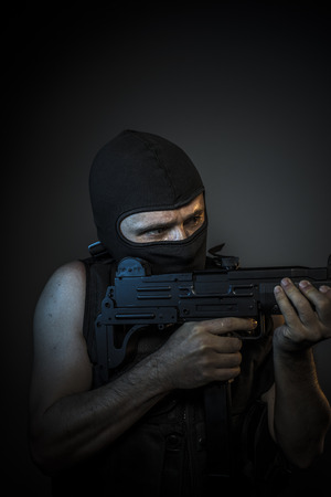 red handed: Bandit, Man wearing balaclavas and bulletproof vest with firearms Stock Photo