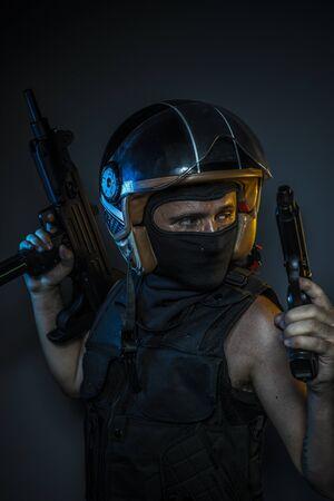 murderer: Danger, murderer with motorcycle helmet and guns