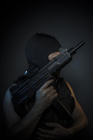 bulletproof vest: Criminal, Man wearing balaclavas and bulletproof vest with firearms