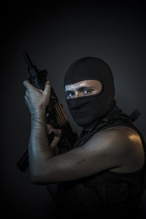 bulletproof vest: Thief, Man wearing balaclavas and bulletproof vest with firearms