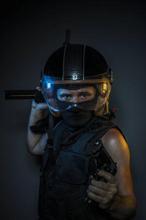 murderer: murderer with motorcycle helmet and guns Stock Photo