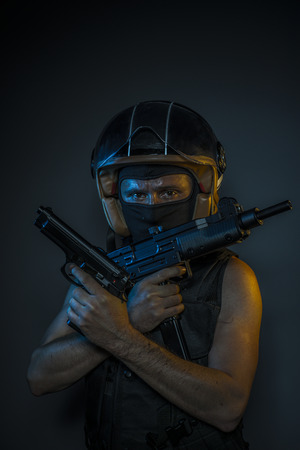 murderer with motorcycle helmet and guns Stock Photo