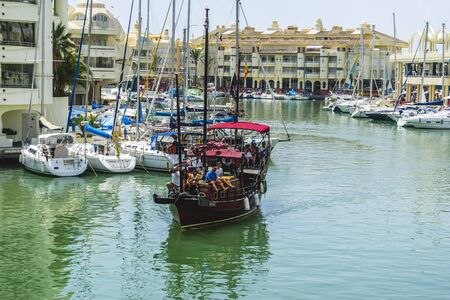 marina life: pirate boat moored in Marbella, Spain city summer