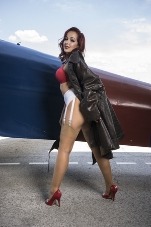 Sensual, pinup dressed in era of the Second World War, beauty redheaded woman