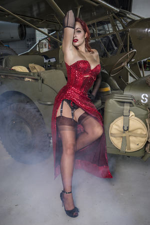 beautiful woman with pinup style of the Second World War, along with vintage aircraft