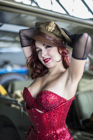 WWII, beautiful woman with pinup style of the Second World War, along with vintage aircraft