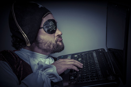 hijack: Violation, computer security, hacker pirate dress with hat and skull