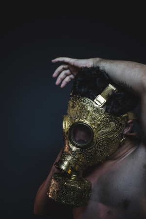 armageddon: armageddon, depression and danger man with golden gas mask Stock Photo