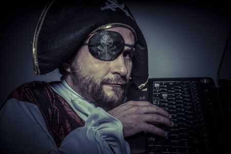 piracy: Piracy, computer security, hacker pirate dress with hat and skull Stock Photo