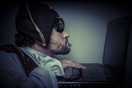 violating: Spy computer security, hacker breaking into a laptop and violating safety Stock Photo