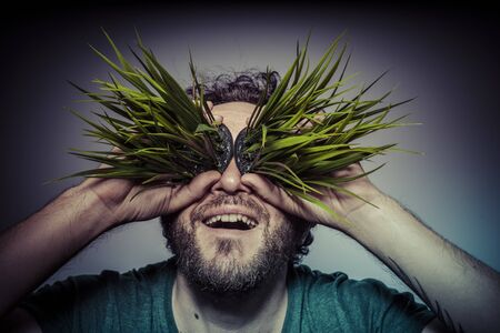 veganism: veganism concept man with green grass in the mouth