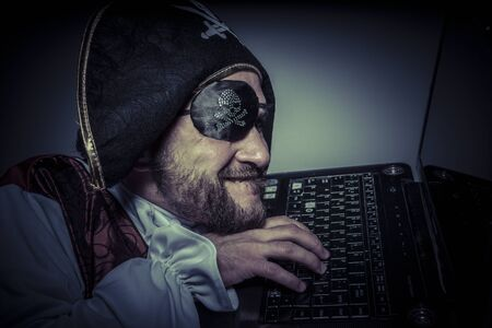 violating: Cracker, Spy computer security, hacker breaking into a laptop and violating safety