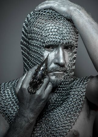 hooded: Murder, medieval executioner mesh iron rings on the head
