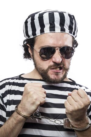 jailhouse: Locked, Desperate, portrait of a man prisoner in prison garb, over white background Stock Photo