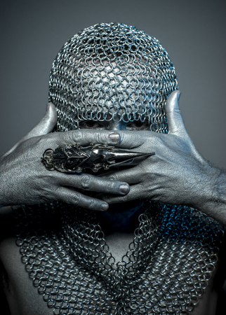 terrify: medieval executioner mesh iron rings on the head Stock Photo