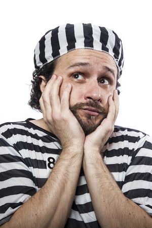 jailhouse: Outlaw, Desperate, portrait of a man prisoner in prison garb, over white background Stock Photo