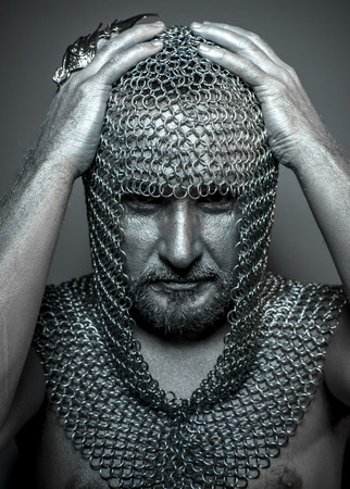 hooded: Hooded, medieval executioner mesh iron rings on the head Stock Photo