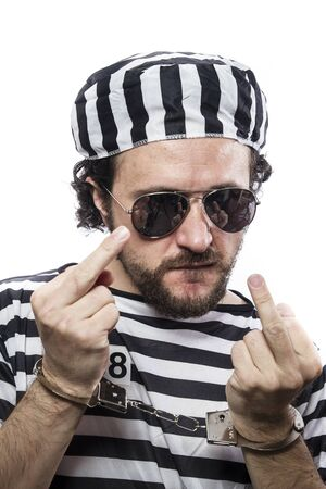jailhouse: Desperate, portrait of a man prisoner in prison garb, over white background Stock Photo