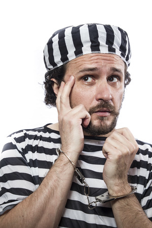 desperate: Desperate, portrait of a man prisoner in prison garb, over white background Stock Photo