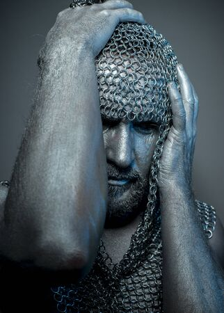 historical: Horror, medieval executioner mesh iron rings on the head