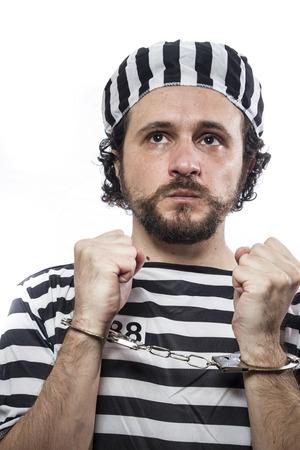 imprisoned person: Incarcerated, Desperate, portrait of a man prisoner in prison garb, over white background