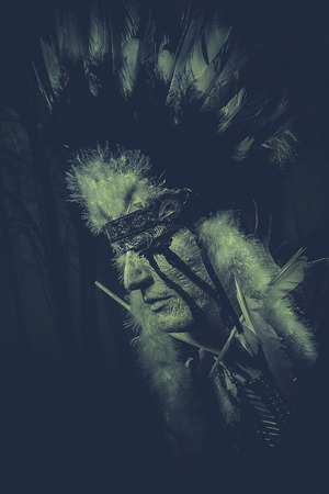 warrior tribal tattoo: American Indian warrior, chief of the tribe. man with feather headdress and tomahawk