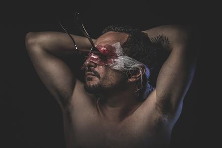 murderer: Murderer, bloody fork eyes fixed on man