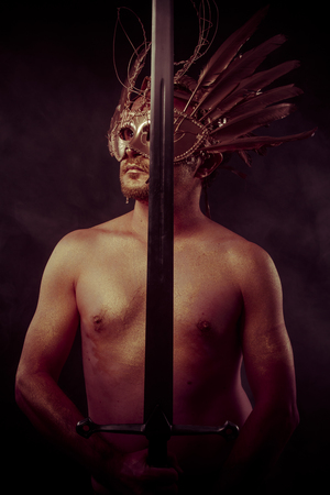 gold dust: warrior with golden mask and huge iron sword, body covered with gold dust