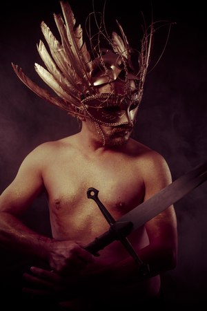 gold dust: Protection, warrior with golden mask and huge iron sword, body covered with gold dust