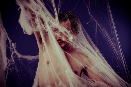 man trapped: Halloween, mental disorders, man trapped in a giant spider web