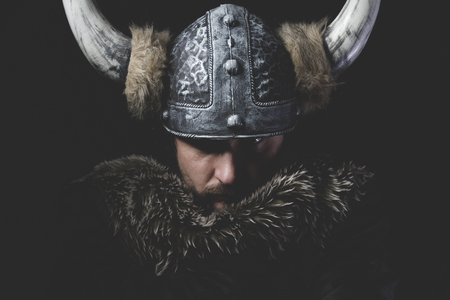 warrior: Danger, Viking warrior with iron sword and helmet with horns