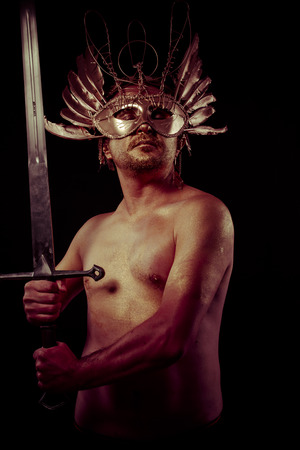 gold dust: Strength, warrior with golden mask and huge iron sword, body covered with gold dust