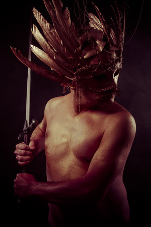 gold dust: Empire, warrior with golden mask and huge iron sword, body covered with gold dust