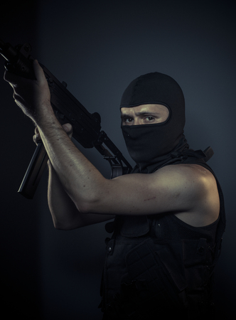 outlaw: Outlaw, terrorist carrying a machine gun and balaclava