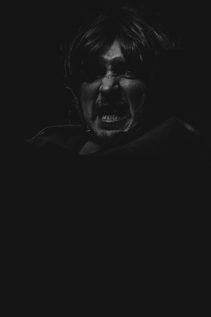contrasts: Hell, vampire man with great contrasts of light, large black cloak