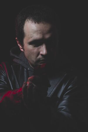 holding gun to head: Sadness, Man with intent to commit suicide, gun and leather jacket, red backlight