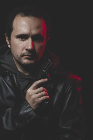 intent: Expression, Man with intent to commit suicide, gun and leather jacket, red backlight