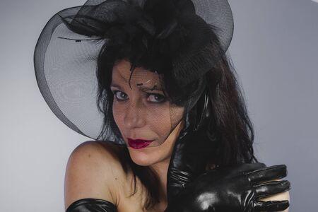 Darkness, widow with sensual look, dangerous woman Stock Photo