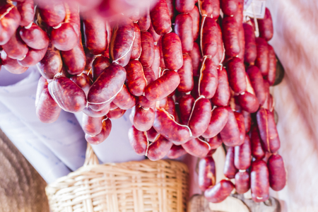 chorizos: lots of sausages and chorizos in a medieval fair Stock Photo