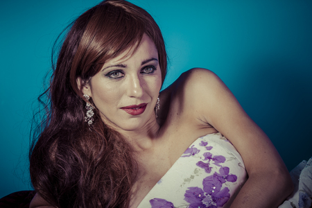 red haired woman: Beautiful red haired woman in white dress with flowers and sensual look