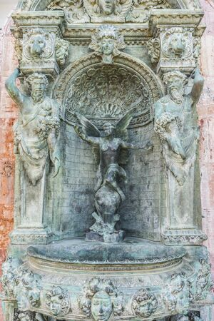 angels fountain: bronze fountain with figures of angels in Marbella Andalucia Spain