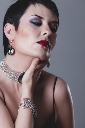 20s: fashioned, sexy girl with jewelry and style of the 20s