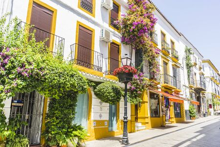 traditional Andalusian streets with flowers and white houses in Marbella, Andalucia Spain Imagens