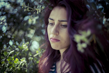long depression: depression melancholic girl in a forest in autumn, red long hair
