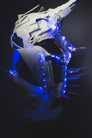 futuristic girl: Machine Blue LED lights armor made with plastics and lightweight materials. Stock Photo