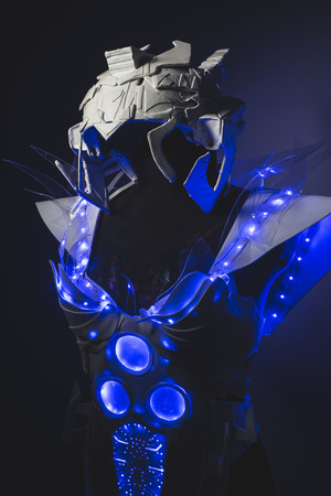 futuristic girl: Fiber optics Blue LED lights armor made with plastics and lightweight materials.