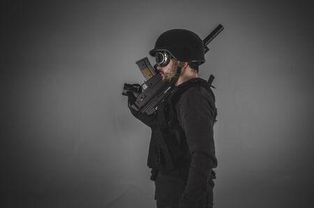 bulletproof vest: guard, airsoft player with gun, helmet and bulletproof vest on gray background
