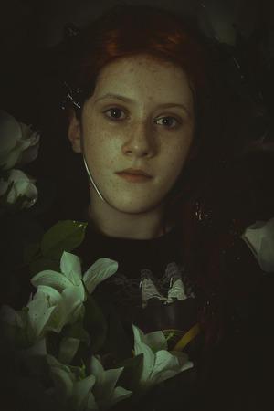 corpse flower: young girl lying in water, romantic scene