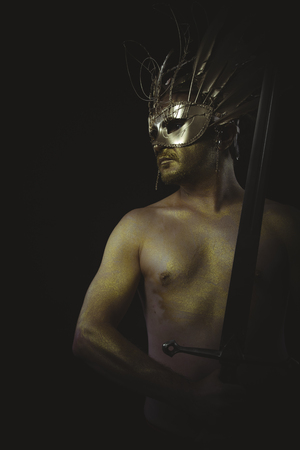 crusades: medieval, warrior helmet and gold feathers, giant iron sword Stock Photo