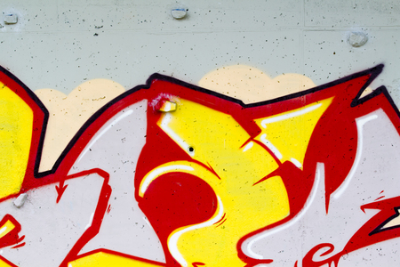 defiance: typography and color lines, segment of an urban grafitti on wall